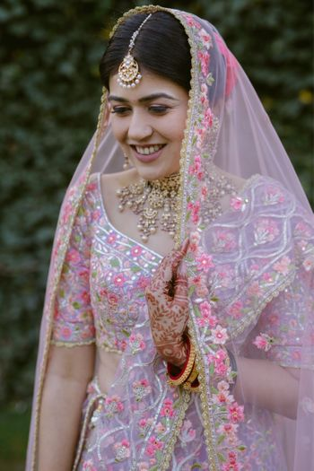 Photo of Unique bridal lehenga with lavender and pink