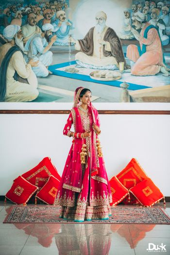 Photo of Hot Pink Bridal Lehenga with Mint Border