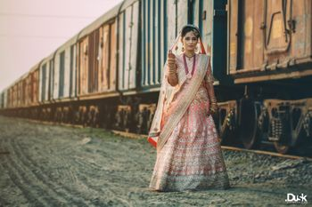 Photo of White and Pastel Peach Lehenga with Pastel Mint Border