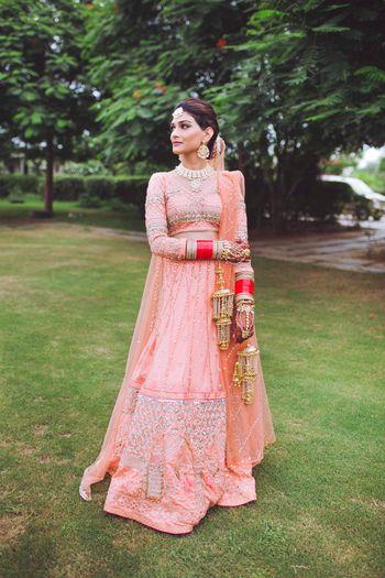 Photo of Peach bridal lehenga with full sleeves