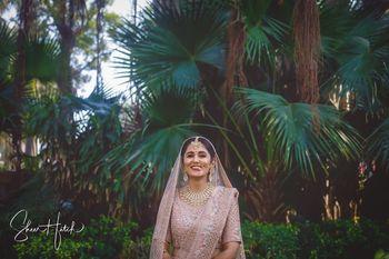 Outdoor bridal shoot in pink lehenga