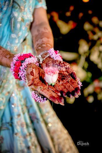 Bridal mehendi photography with flower