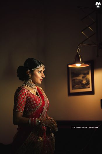 Photo of Bridal room portrait with bride wearing red