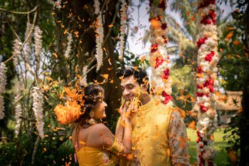 Floral haldi photo with couple