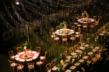 Long table setting with fairy lights all over