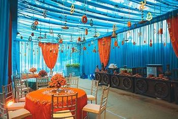 Mehendi decor idea with orange and blue decor