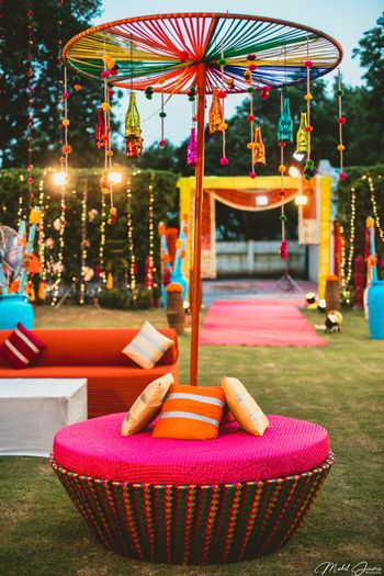 Seating canopy idea for mehendi with hanging bottles