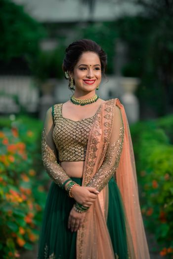 Dark green and peach lehenga