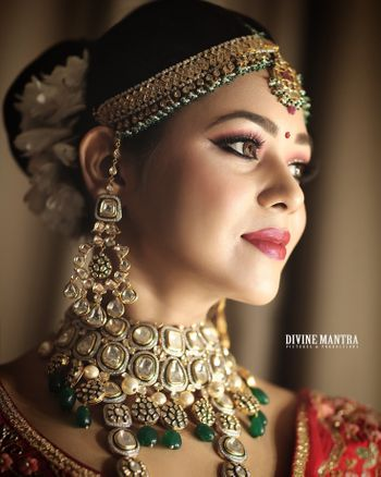 Photo of Polki bridal necklace and earrings with green beads