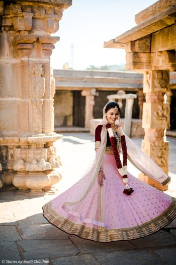 Photo of Twirling bride in simple pink lehenga