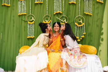 A bride on her haldi function with her bridesmaids