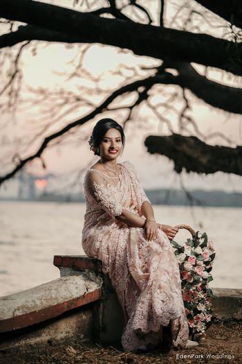 Bride wearing white lace saree