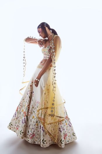 White lehenga with yellow ombre lehenga
