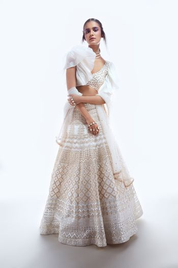Sister of the bride lehenga in white with frill sleeves