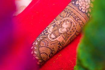Mehendi with bridal portrait on arm