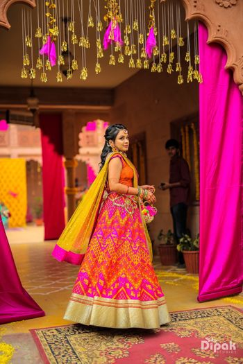 Orange and pink zig zag print mehendi lehenga