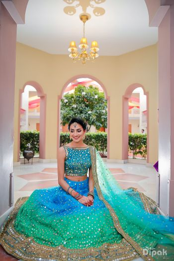 Photo of Blue and turquoise ombre lehenga with mirror work