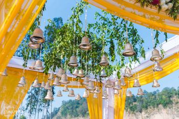 Photo of Mandap decor idea with hanging bells