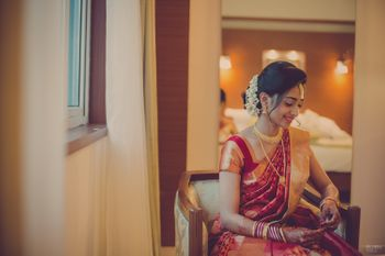 Photo of Candid Bride in Red Saree and Gajra