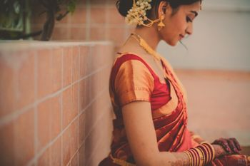 Photo of Smiling Bride in Red Saree Candid Shot