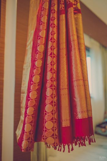 Photo of Red and Gold Silk Kanjivaram Saree