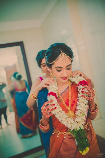 Photo of Bride Fixing Var Mala Candid Shot