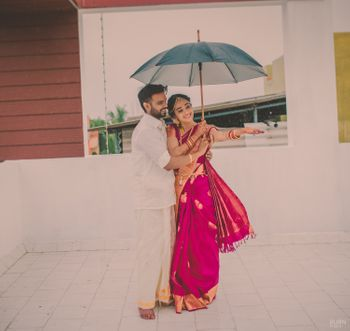 Photo of Couple Under the Umbrella Candid Shot