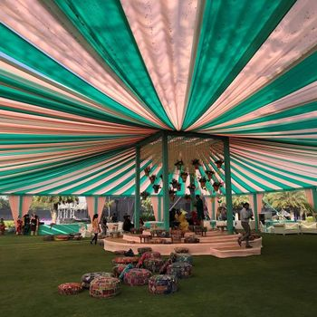 A pink and green tent decor at a day wedding