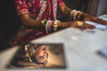 Creative bride looking in mirror shot