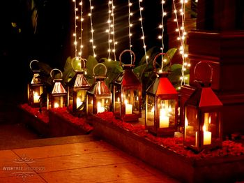 Photo of Gold Lanterns with Dim Candles and Fairy Lights Decor