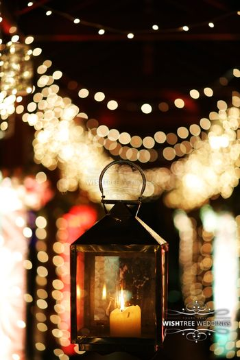 Photo of Gold Lanterns with Candles and Fairy Lights Backdrop
