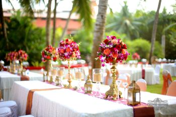 Photo of Tall table centerpieces in red and purple