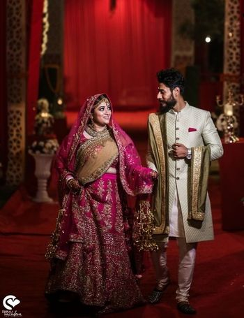 Couple portrait with bride in pink lehenga