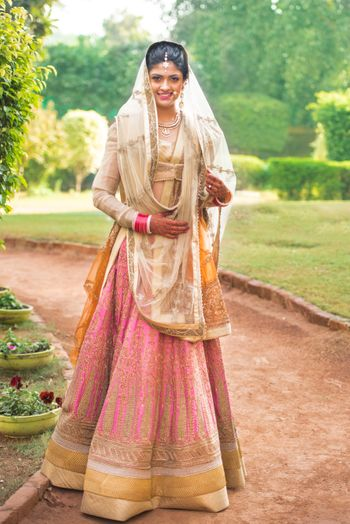 pink bridal lehenga with off white blouse