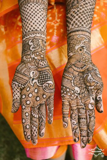 Unique modern bridal mehendi design on both hands