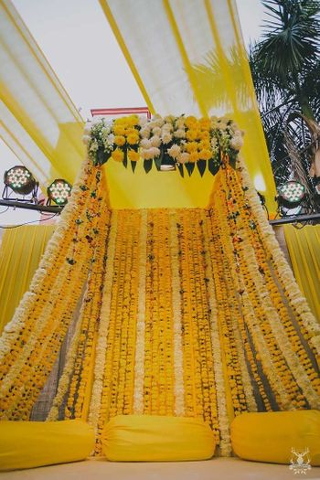 Floral tent decor with yellow marigolds and genda phool