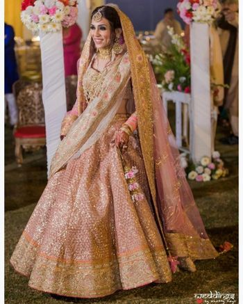Pastel bride in pink sequin work lehenga