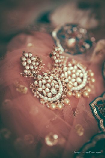 Photo of Earrings on dupatta bridal jewellery shot