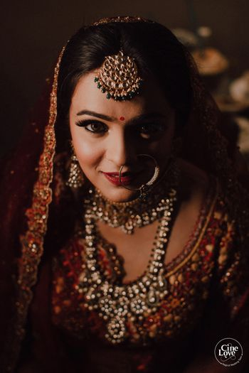 Photo of Bride in red close up shot with shadow