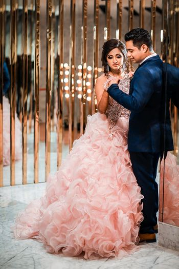 Light pink ruffled gown for engagement
