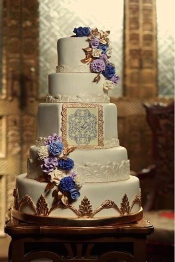 Photo of multi story white and purple wedding cake