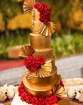 Glamorous gold and red wedding cake