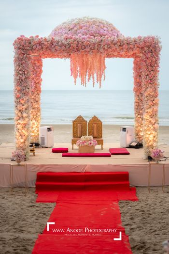 A  minimal, floral mandap against the sea
