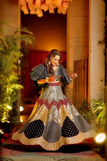 Patchwork lehenga with black and gold work and cape
