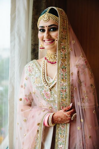 Light pink lehenga for morning bride with florals