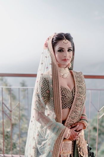 Photo of Teal bridal sabya lehenga with smokey eyes