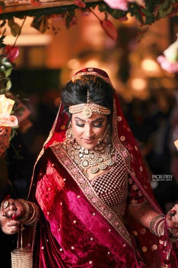 Winter bride wearing maroon velvet lehenga