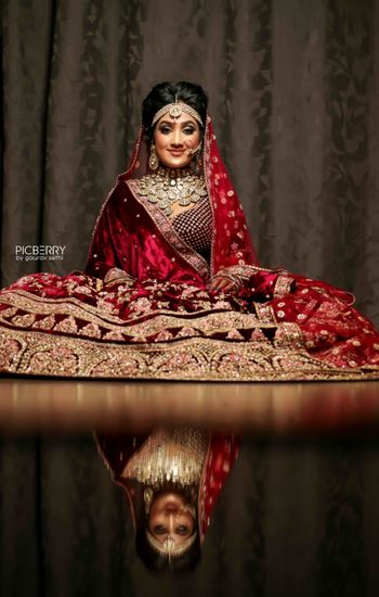 Reflection shot with bride in maroon lehenga