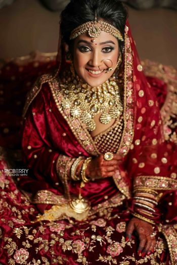 Heavy bridal look in maroon velvet lehenga