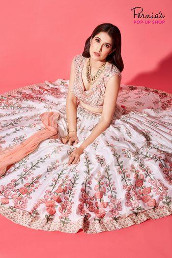 White and red floral print lehenga for mehendi